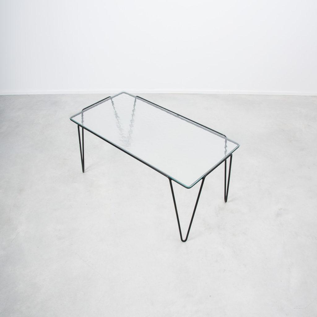 Buena De Mesquita glass coffee table