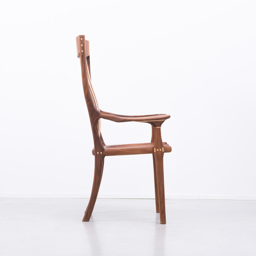 A walnut and maple chair in manner of Sam Maloof
