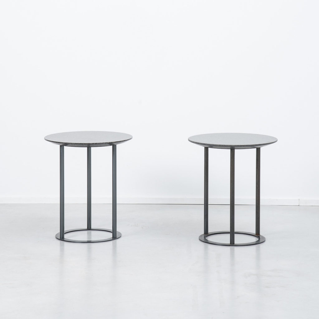 Pair of round granite modernist side tables