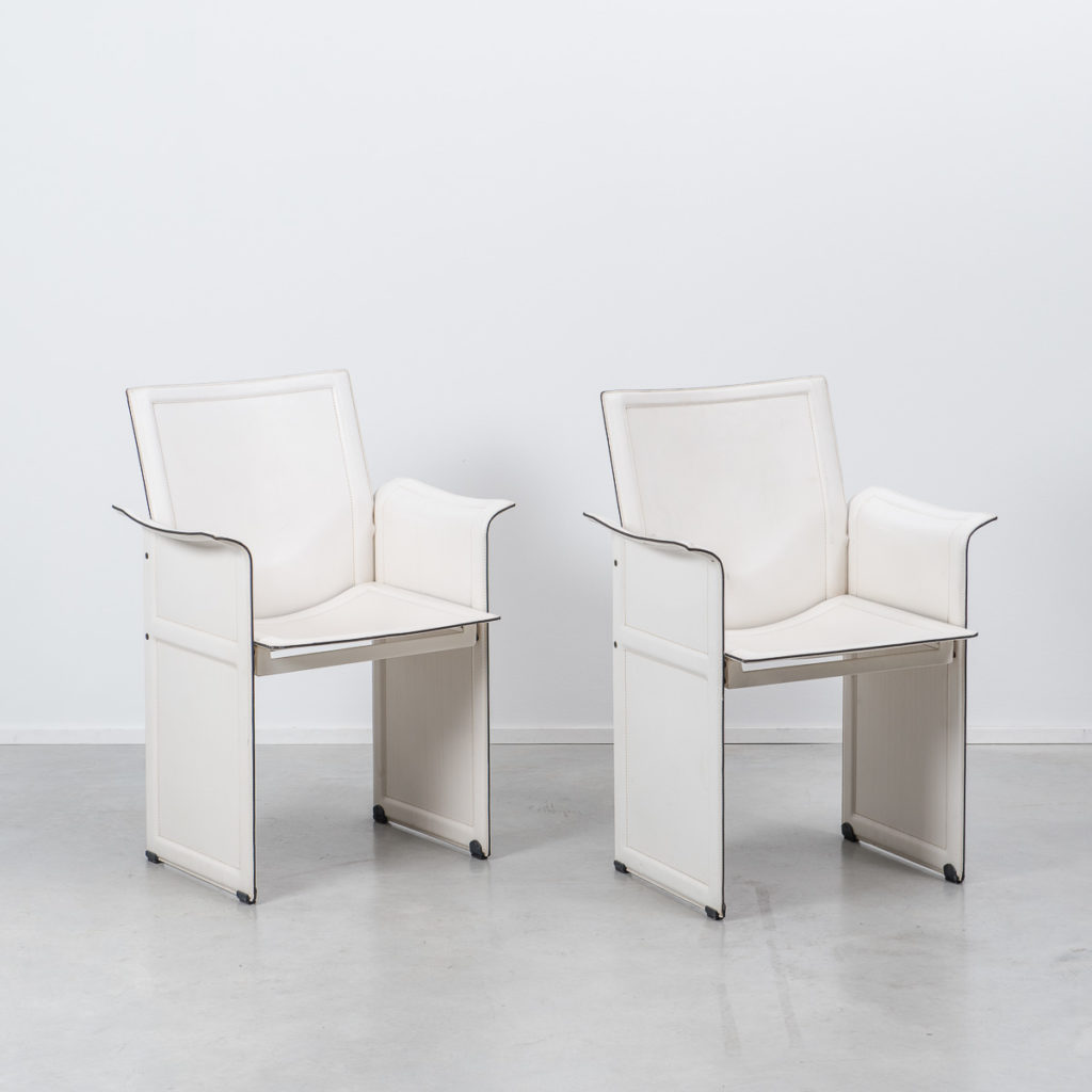 Beton In Form a pair of leather korium chairs from designer tito béton brut