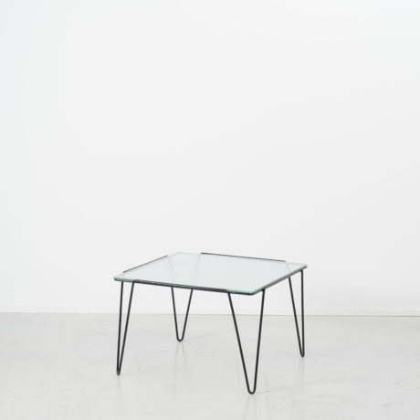 Buena De Mesquita glass coffee table