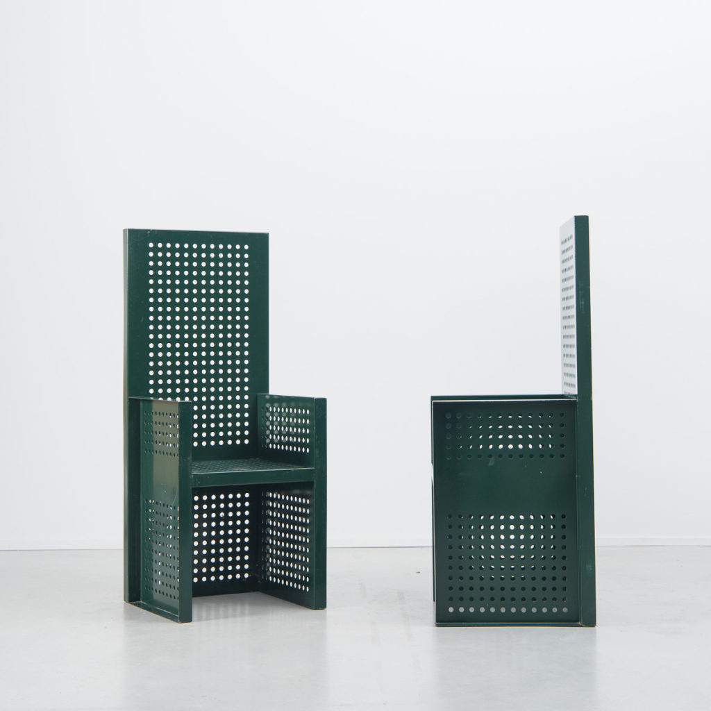 Green perforated metal chairs