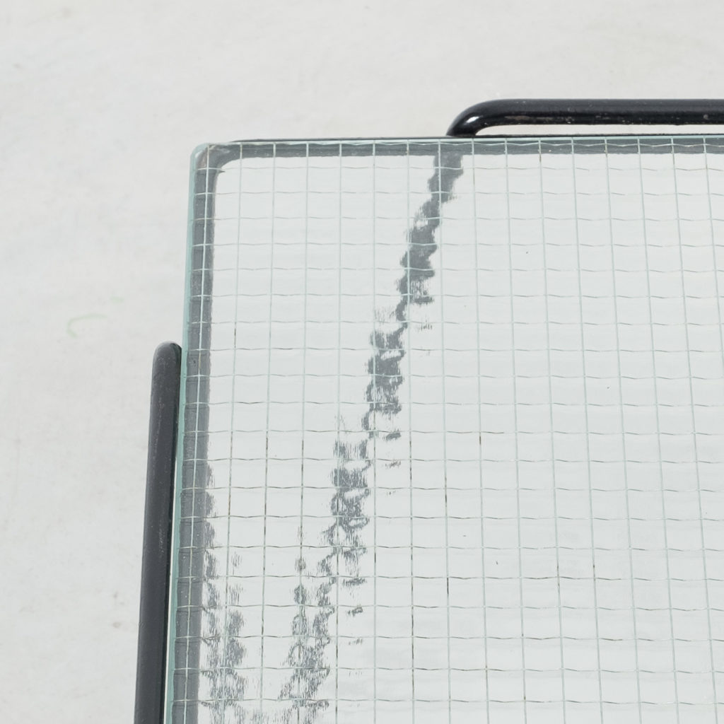 Bueno De Mesquita glass coffee table