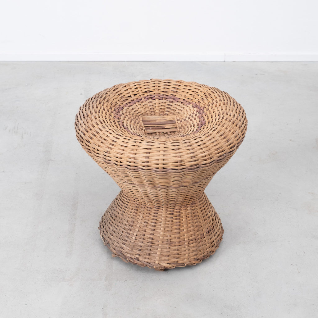 A pair of rustic rattan stools