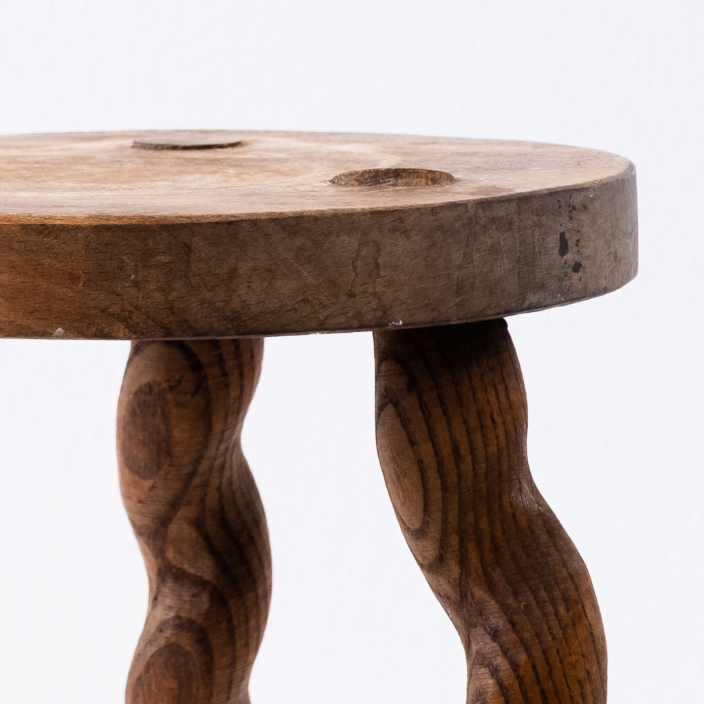 Wavy wooden legged stool