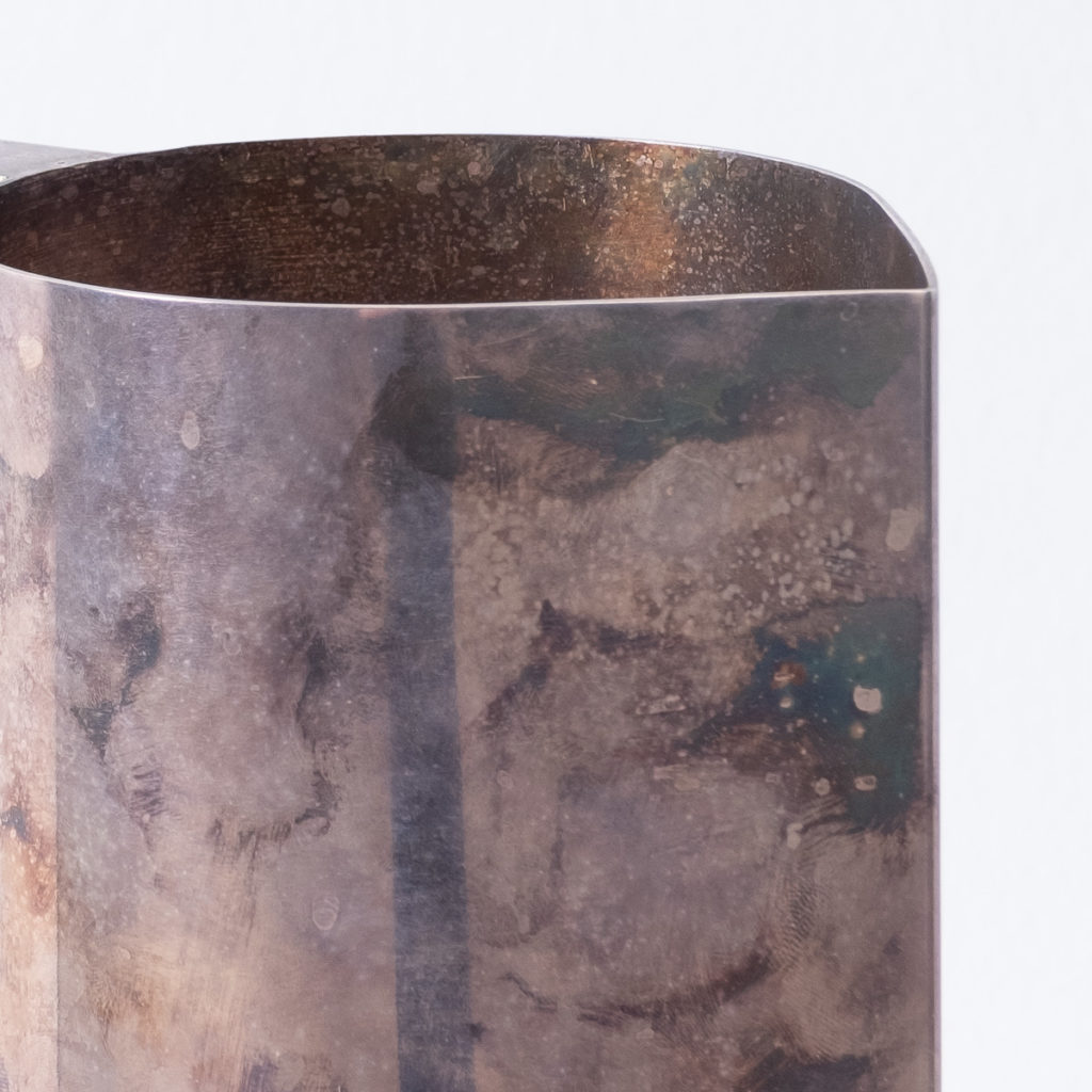 Patinated silver pitcher