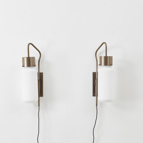 A pair of Bidone wall lights by Luigi Caccia Dominioni