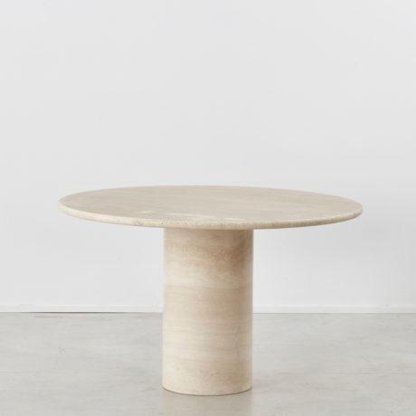 Travertine pedestal dining table