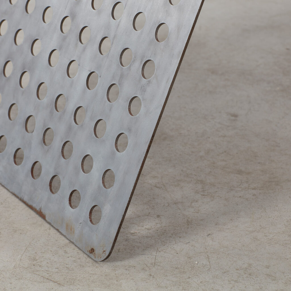 Perforated aluminium metal table