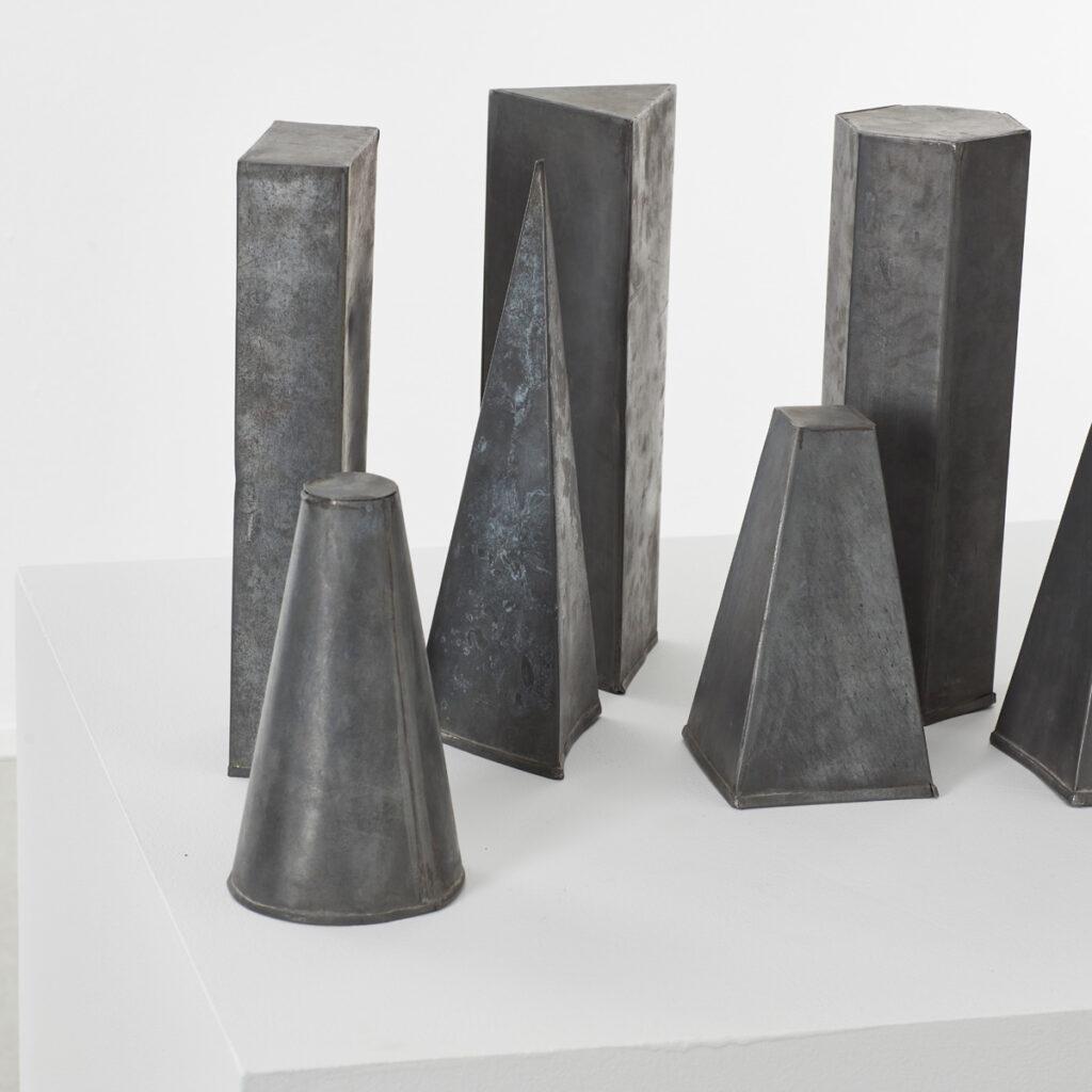 Eight zinc geometric shapes