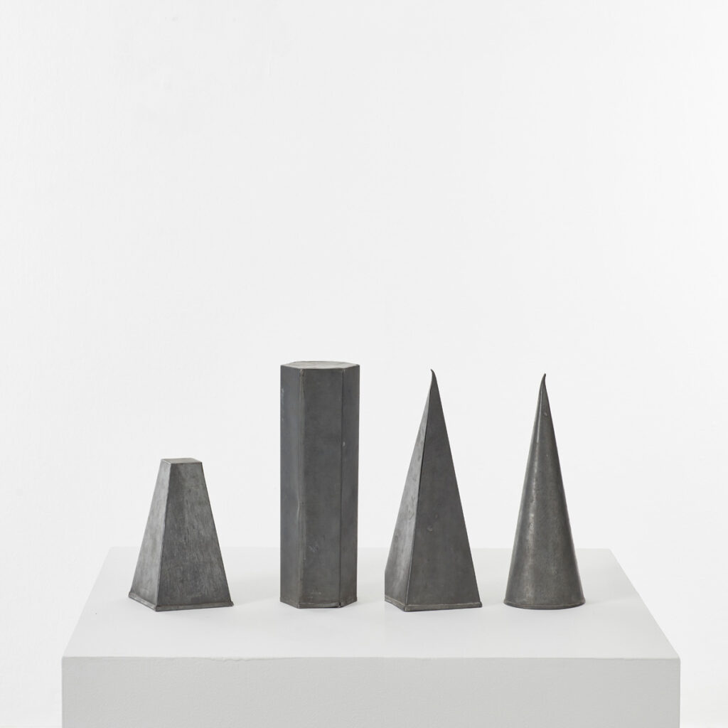 Four zinc geometric shapes