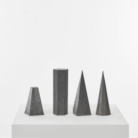 Four zinc geometric shapes