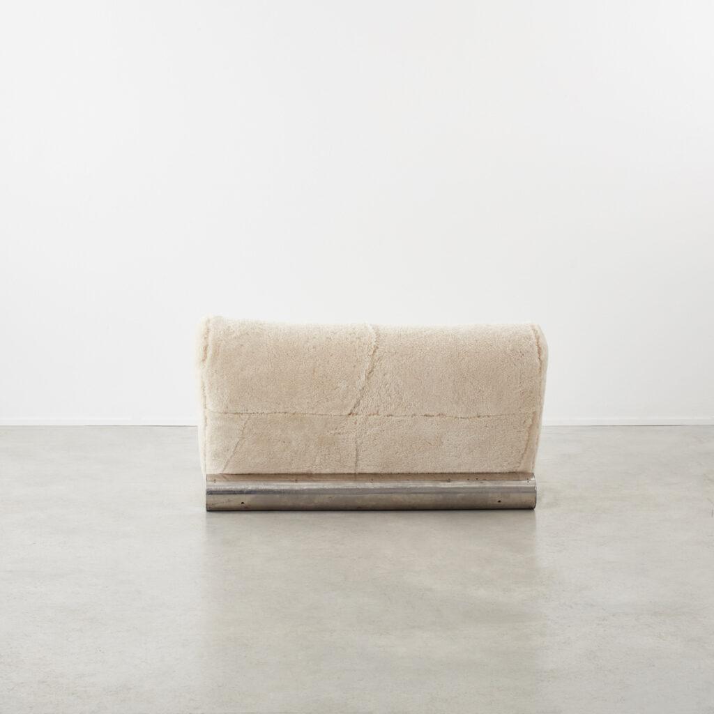 Postmodern loveseat in sheep pelt