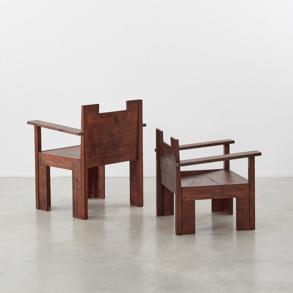 His and hers Brutalist wooden chairs