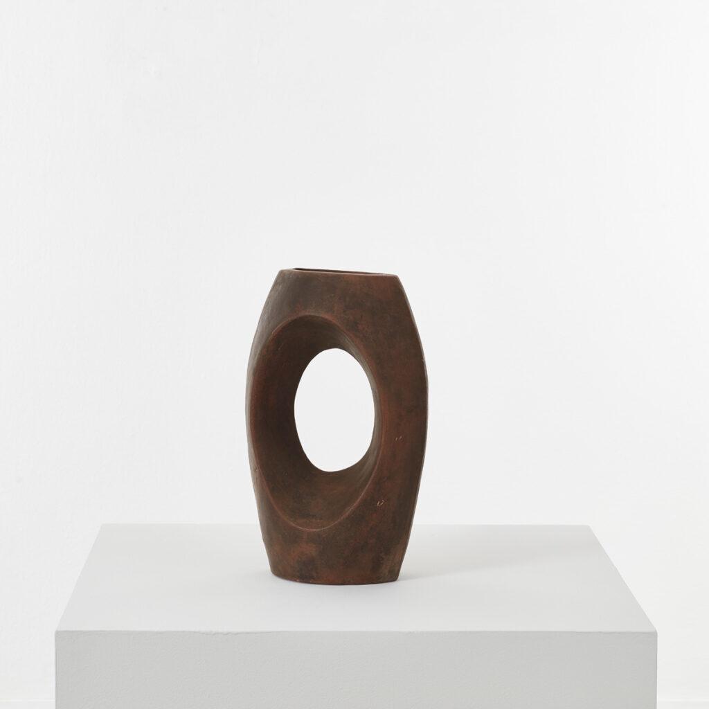 Pierced studio pottery vase in terracotta