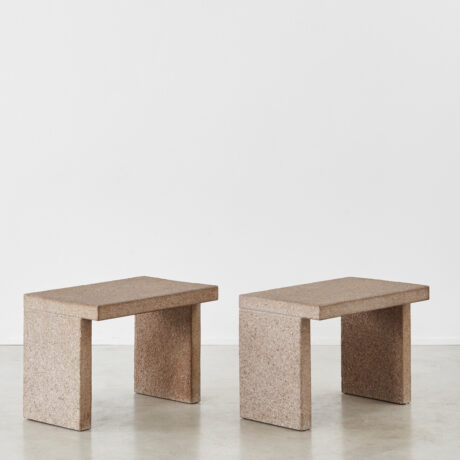 Two minimalist stone side tables